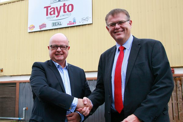 Phil Storer, of Pooling Partners, with Tayto Group's Nigel Smith